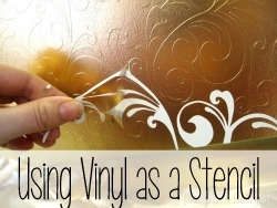 Apply a vinyl decal to furniture, then spray paint... and peel off the vinyl for an awesome effect!