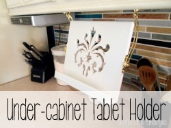 Build a Tablet Holder that mounts under your cabinets, and folds up underneath when it isn't in use!