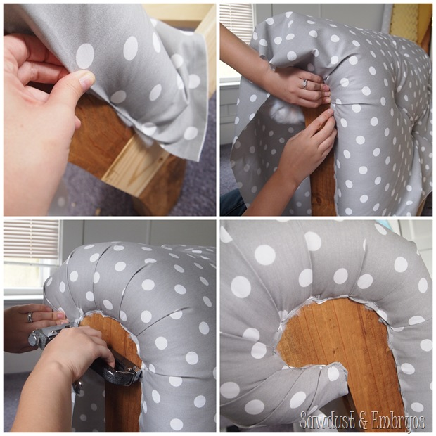 Upholstering the arm of a fainting couch toddler bed.