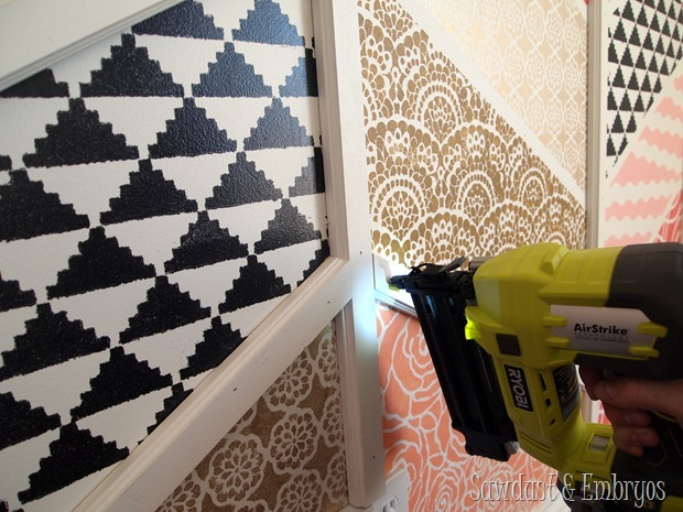 Installing trim boards for Herringbone pattern accent wall {Sawdust and Embryos}