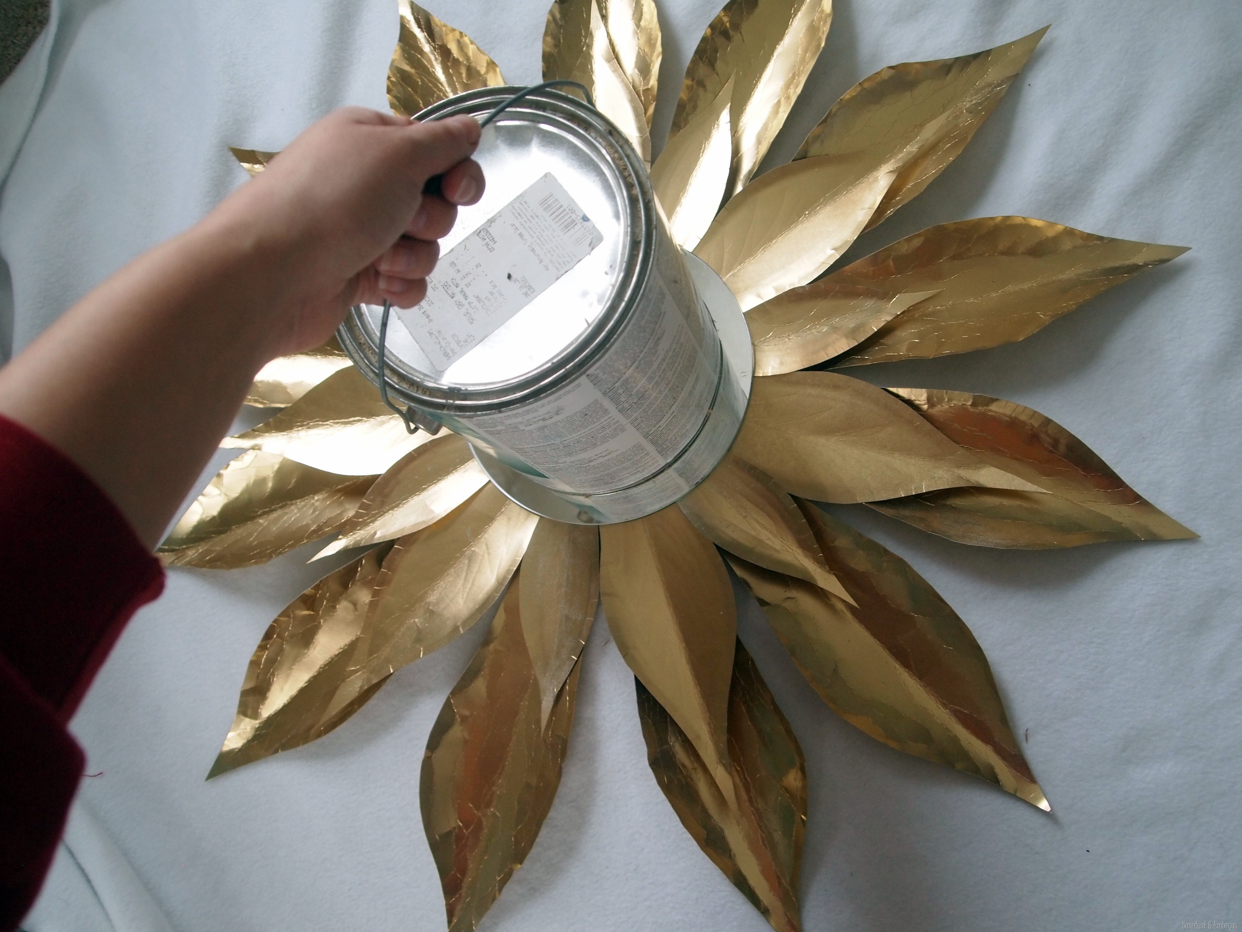 put something heavy on your diy starburst mirror while the glue is drying sawdust and