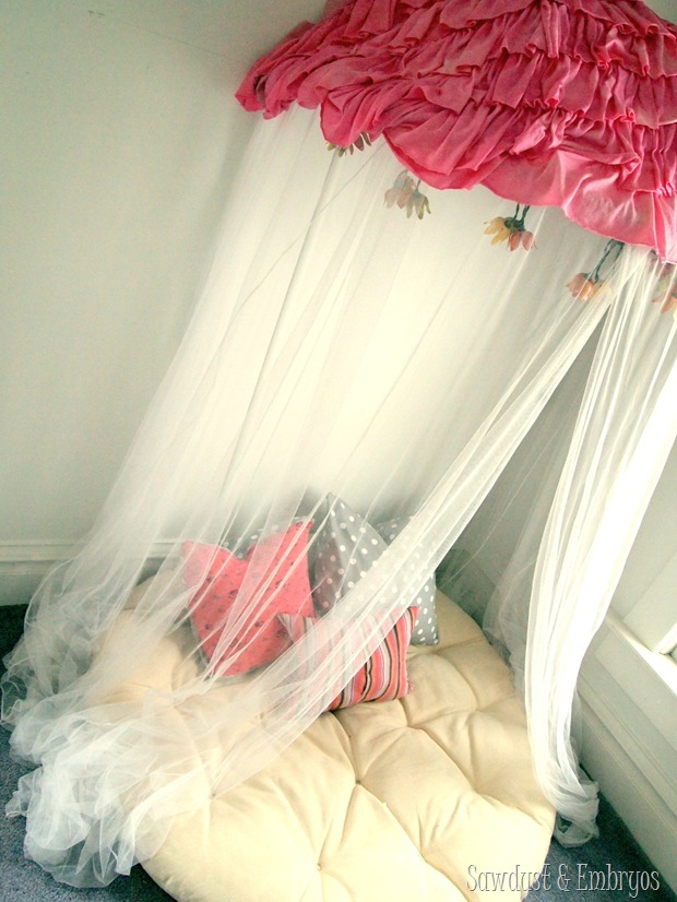 Make a children's reading nook 'canopy' using a papasan chair (cut in half) installed on the wall with the cushion below!