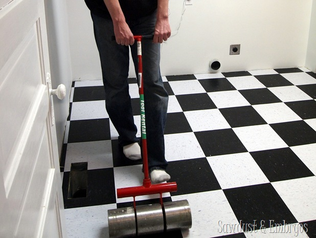 Using a tile roller on CVT flooring {Sawdust and Embryos}
