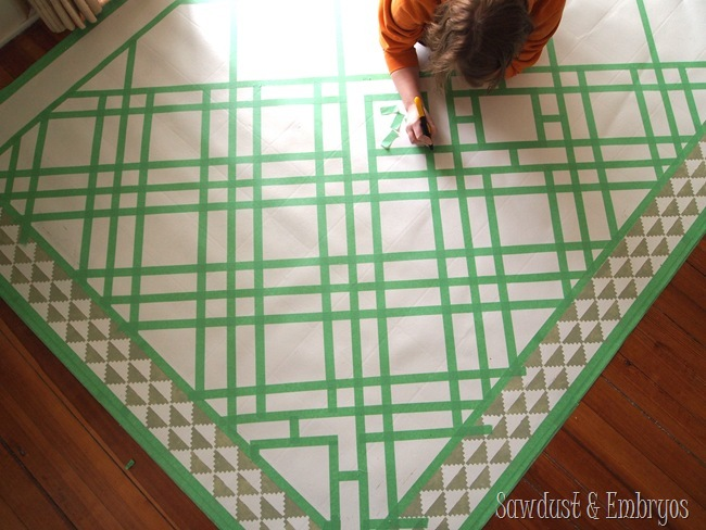 Buy a remnant of linoleum to use as a dining room area rug... and paint it in any pattern!
