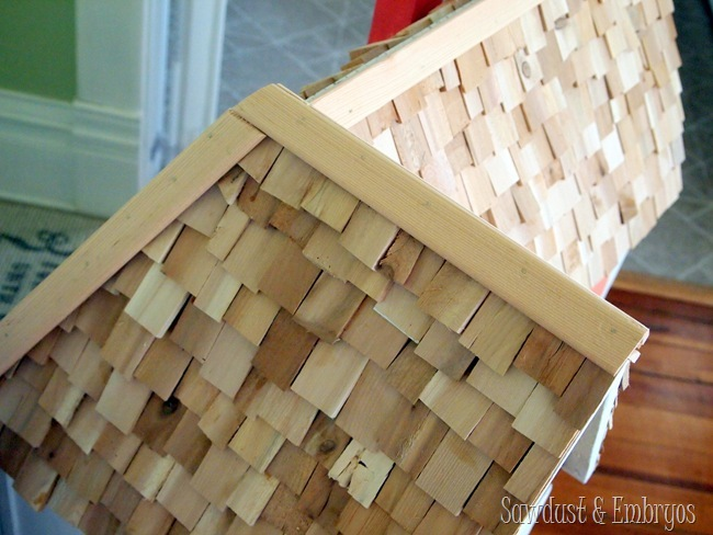 Wood-shim roofing shingles on dollhouse {Sawdust and Embryos}