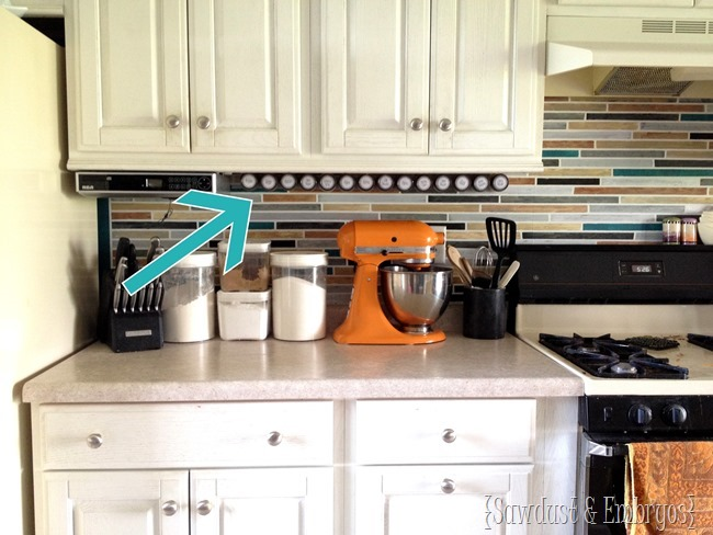 Affix spice jars under your cabinetry using a velcro-like technology... so smart! {Sawdust and Embryos}