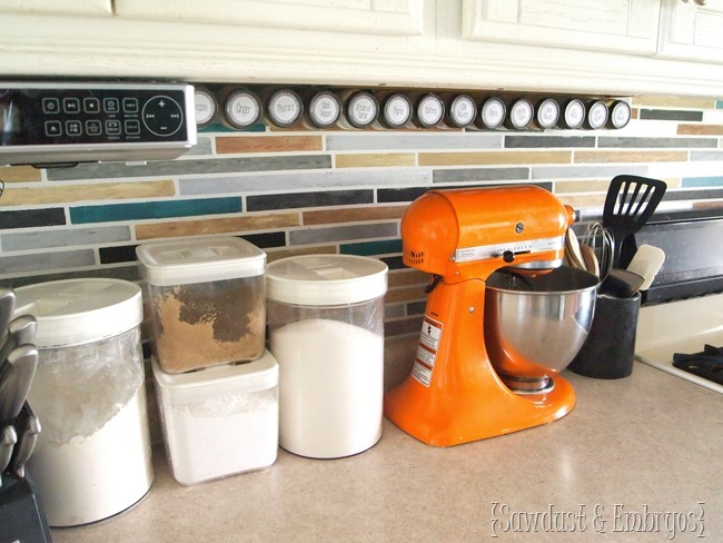 Affix spice jars under your cabinets using a velcro-like technology... genius! {Sawdust and Embryos}