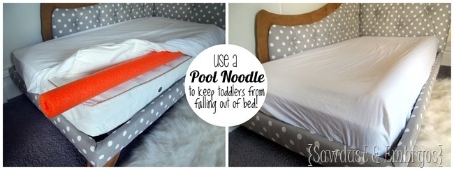 Use a pool noodle under the mattress pad to create a 'lip' and keep your toddler from rolling out!