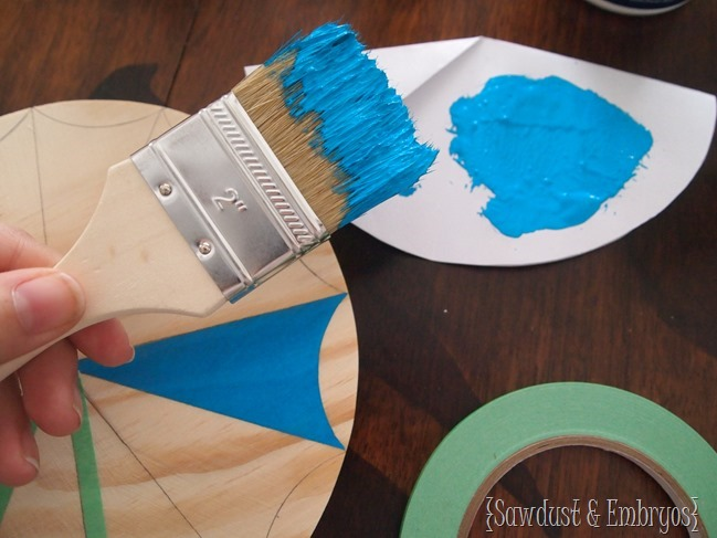 Make your own paint brush starburst clock or mirror! {Sawdust & Embryos}