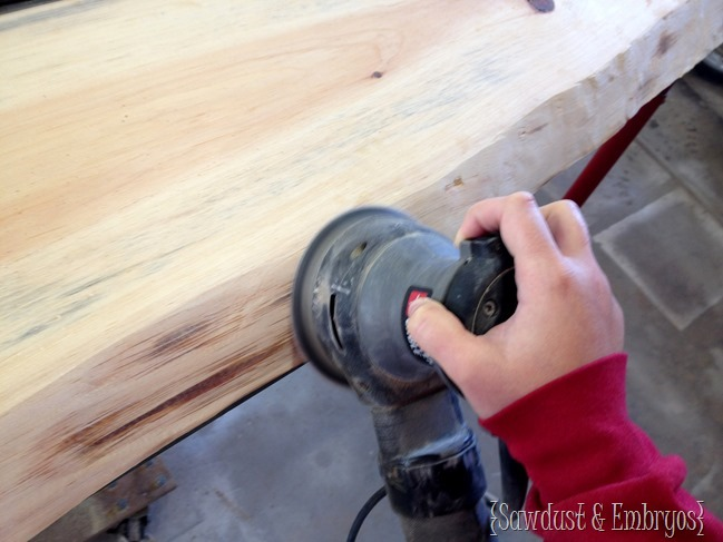 Sanding live-edge wood after removing bark {Sawdust and Embryos}