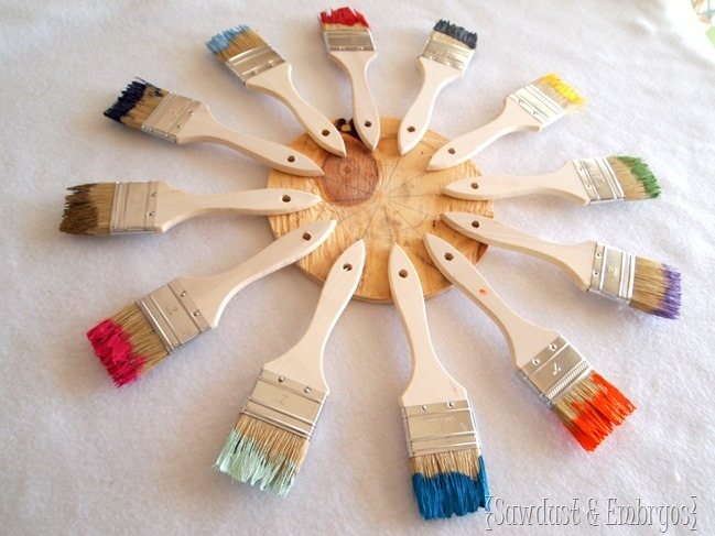 Use paint brushes dipped in different colored paints to create a unique starburst clock or mirror! {Sawdust and Embryos}