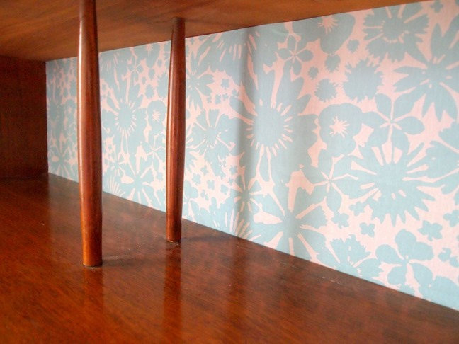 Add strips of removable wallpaper to the back of a hutch for a quick custom update! {Sawdust and Embryos}
