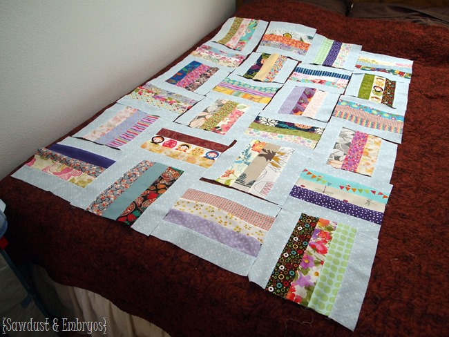 Piecing together a baby quilt made from sentimental scraps of fabric from friends and family members {Sawdust and Embryos}