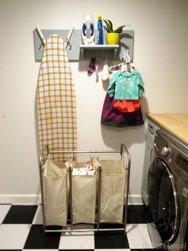 DIY Laundry Room Organizer... holds ironing board, iron, unmatched socks, and hangers {Sawdust and Embryos}