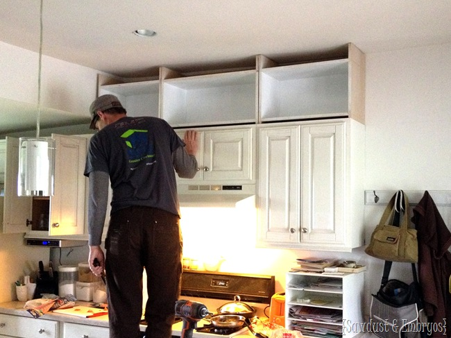 Extending kitchen cabinets to the ceiling.