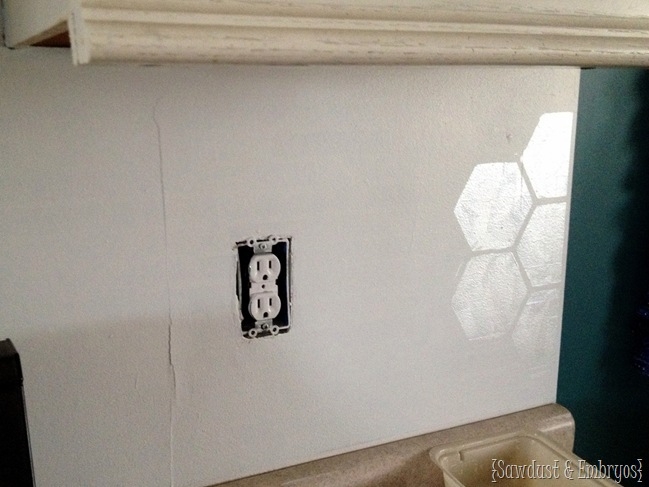 Using a stencil for the backsplash!