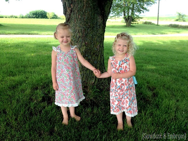 Twins modeling more finished dresses!