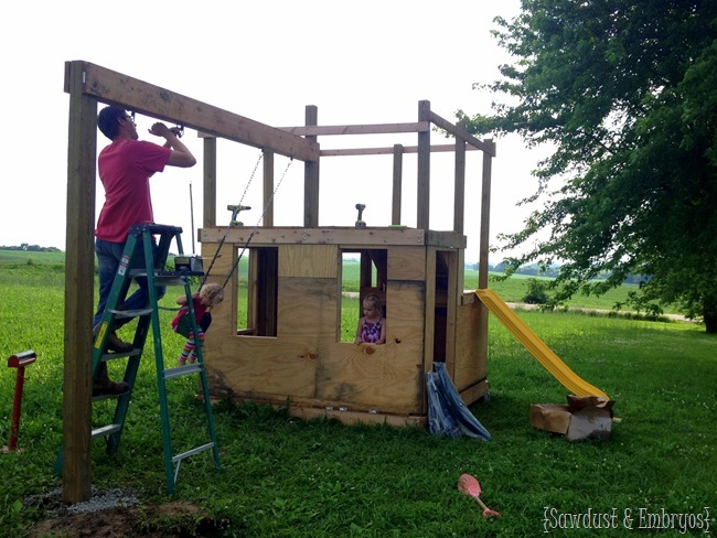 Building a playhouse with an adjoining swingset {Sawdust and Embryos}