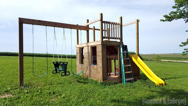 Building a playhouse with slide, swings, and fort on top! {Sawdust and Embryos}
