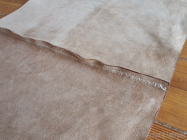 Sewing a leather seam for upholstering a tufted ottoman {Sawdust and Embryos}
