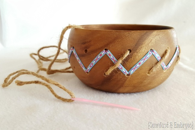 Altering a simple wooden bowl by drilling holes and weaving in ribbon and twine! {Sawdust and Embryos}