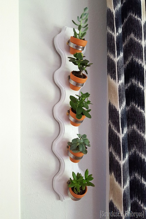 Simple vertical succulent planter using hose clamps and tiny terra cotta pots! {Sawdust and Embryos}
