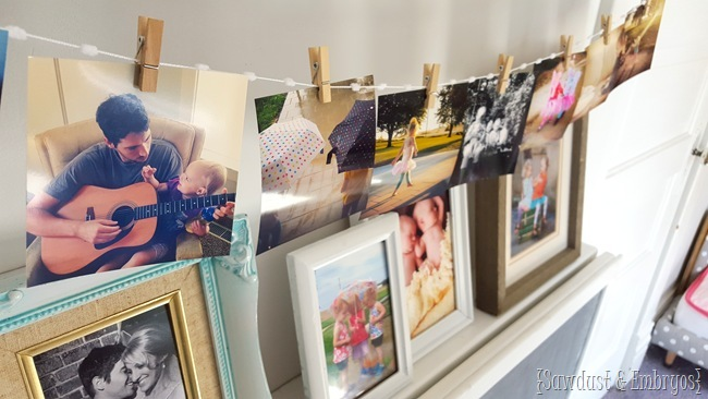 String some instragram prints below a shelf or picture ledge