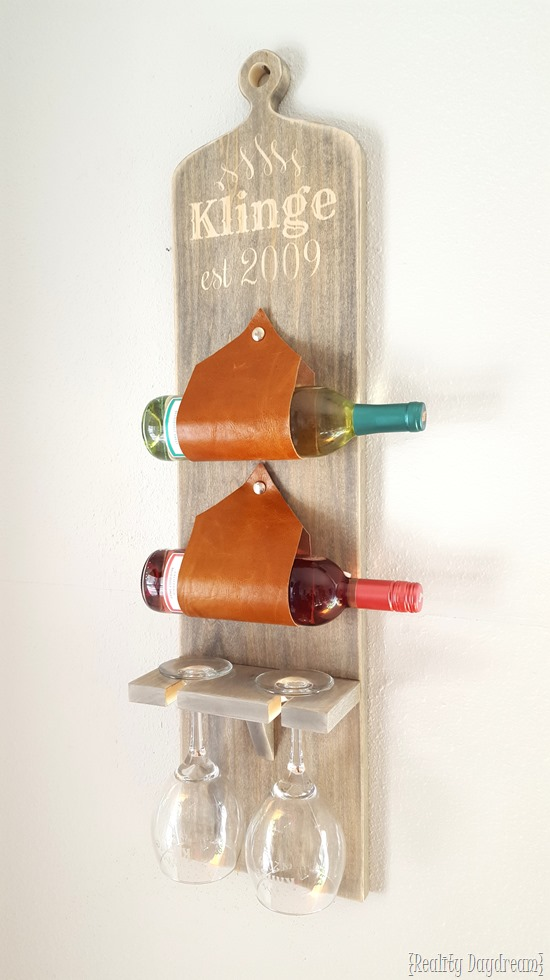 DIY Wall-mounted wine and stemware rack... using leather as the sleeves! {Reality Daydream}