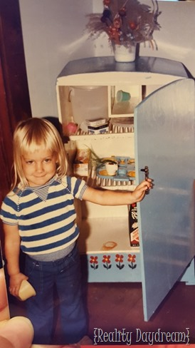 Bethany as a little girl in her play kitchen.