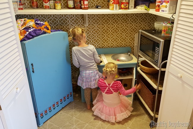 Paisley and Dell in their Play Kitchen.