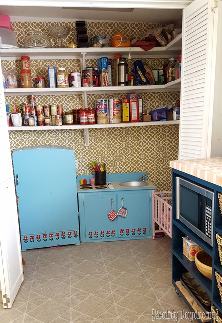 We put the play kitchen in the pantry where the old washer and dryer used to be.