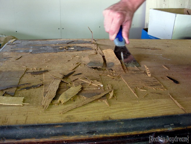 Removing damaged wood veneer with a putty knife. {Reality Daydream}