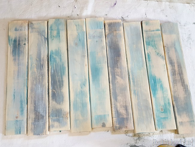 Here are what my boards look like after the light sanding. 3 steps to make brand new wood look like legit old barn boards {Reality Daydream}