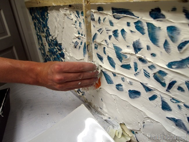 Remove extra grout from your Mosaic Backsplash.