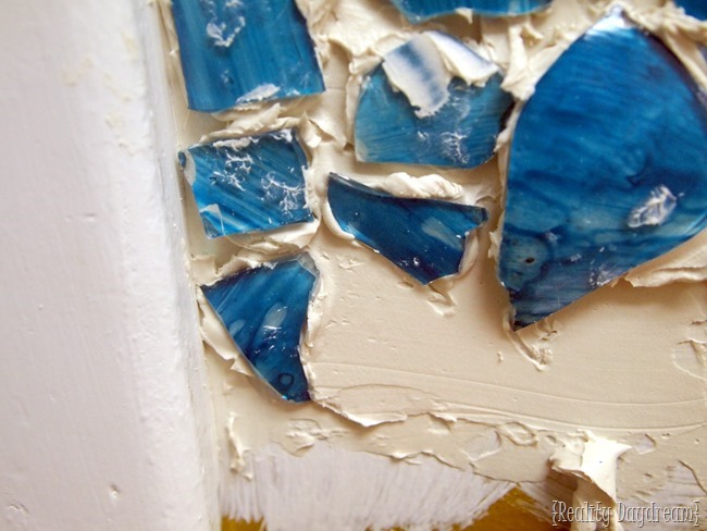 Installing a Mosaic Backsplash made from broken Mason Jars
