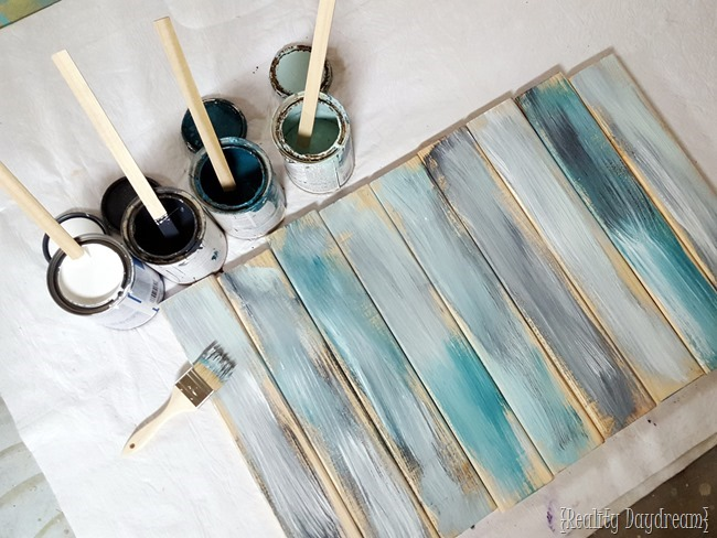 Take your paint colors and slop them on your fresh boards. It doesn't have to be perfect - in fact, imperfect is best for this step! {Reality Daydream}