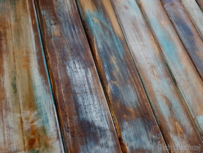 The finished stained wood looks great! SUPER SIMPLE technique for making brand new wood look like old barn boards! {Reality Daydream} #rustic #distressed #farmhouse #barnwood