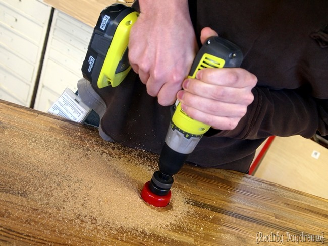 Use a forstner bit to drill hole in the butcher block counter {Reality Daydream}