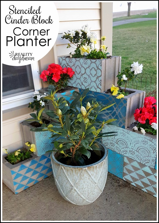 Cinder Block Corner Planter with each block stenciled a different shade