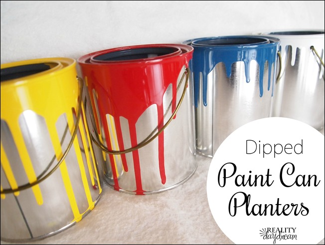 Dip plain empty paint cans in oil-based paint for fun storage or flower pots! {Reality Daydream}