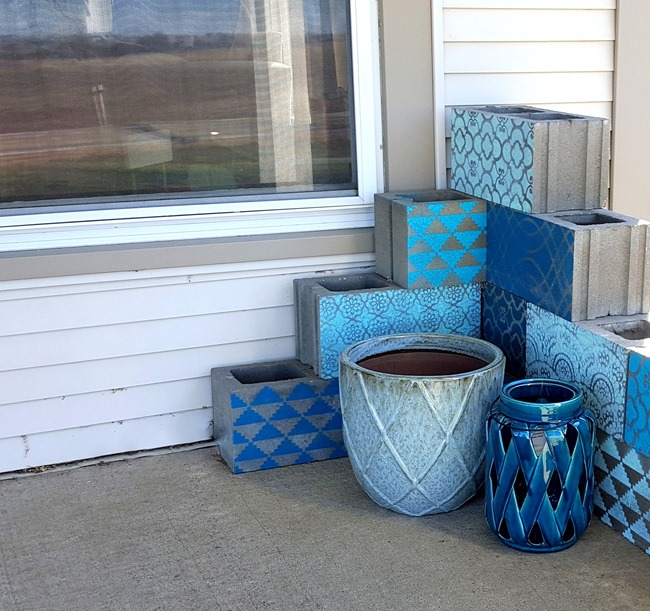 Stencil cinder blocks for a unique corner planter!