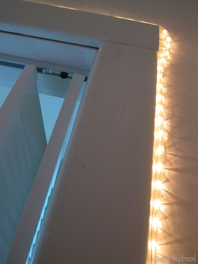 Rope light on inside of closet doorway for a soft glow that won't wake the baby {Reality Daydream}