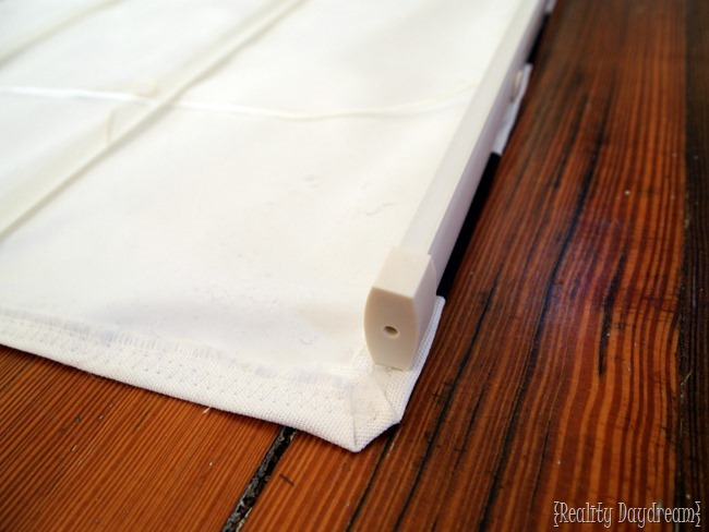 Finish adhering your roman shades to the old mini-blinds.