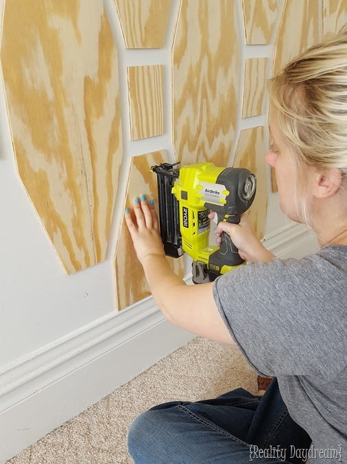Use a brad nailer and plywood shapes to create a unique accent wall {Reality Daydream}