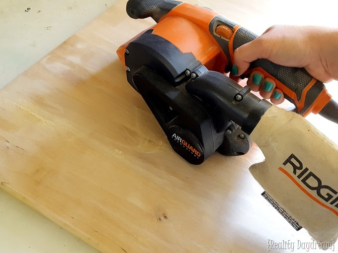 Sanding off an IKEA finish with a belt sander... don't try to strip or use a stripper! {Reality Daydream}