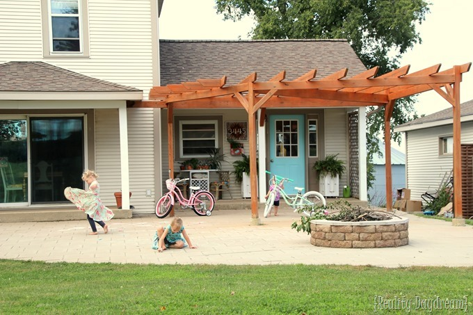 Staining a pergola can make a gigantic difference in the look of your yard!