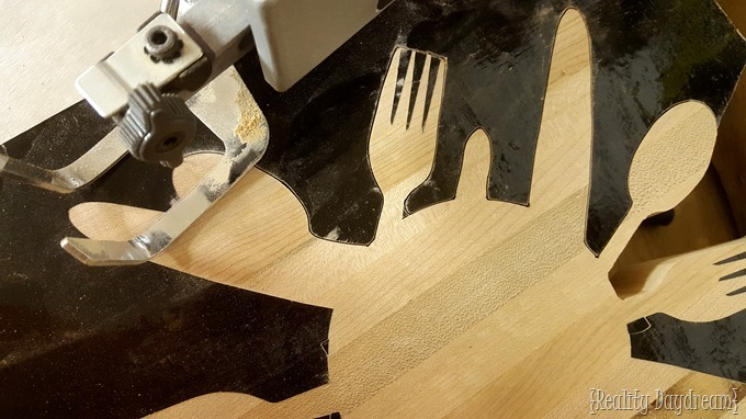 Cut out a 'utensil' design from this butcher block trivet! {Reality Daydream}
