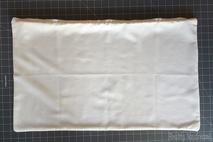 Plain linen pillow cover... ready to be embellished! DIY Tassel Fringe Trim Accent Pillow TUTORIAL!