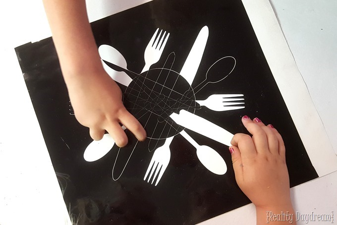 Vinyl Decal Stencil or kitchen utensils to cut a starburst trivet! {Reality Daydream}