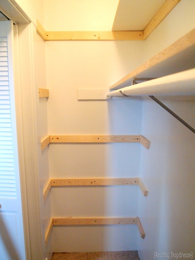 Adding braces for our DIY custom shelving in our builder basic closet! {Reality Daydream}